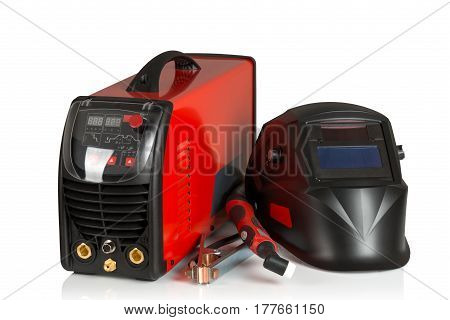welder with protective mask of the welder on a white background