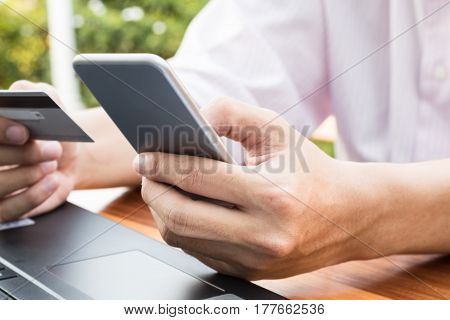Business Money Concept : Man Hand Holding Credit Card Using Online Paying Banking