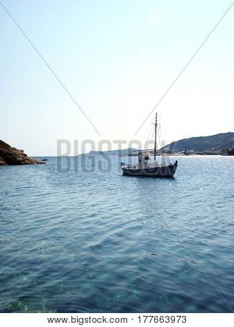 old wood sailboat in Mediterranean Sea Faros harbor on Greek Island of Sifnos