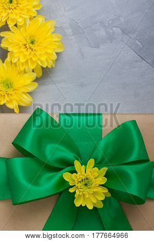 Gift Box With Bow Yellow Chrysanthemums On Grey Concrete Background