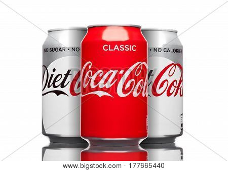 London,uk - March 21, 2017 : Cans  Of Coca Cola Classic And Diet Drink  On White. The Drink Is Produ