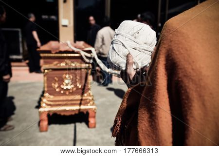 Thai buddhism monk religious praying for the cremation. The corpse in the coffin prepared for burning in the cremate.