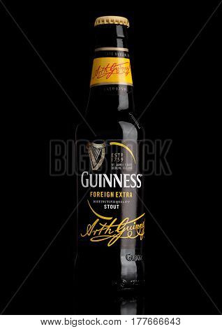London,uk - March 21, 2017 : Bottle Of Guinness Foreign Extra Beer On Black.guinness Beer Has Been P