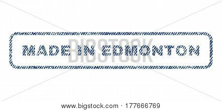 Made In Edmonton text textile seal stamp watermark. Blue jeans fabric vectorized texture. Vector tag inside rounded rectangular banner. Rubber emblem with fiber textile structure.