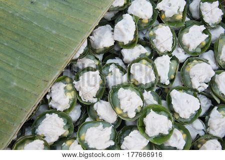 Thai dessert name Kanom Tako- Thai dessert sweet pudding with Coconut Corn Sago Taro wrapped with banana leaves