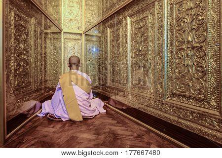 Myanmar nun sitting for meditation in Shwenyaungbin myanmar temple yangon myanmar