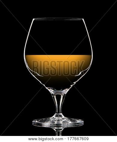 Silhouette of colorful whiskey glass with on black background