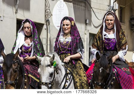CAGLIARI, ITALY - May 1, 2014: 358 Religious Procession of Sant'Efisio - parade of beautiful women in traditional Sardinian costume - Sardinia
