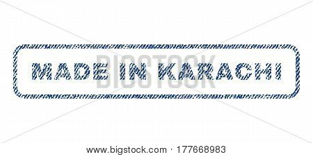Made In Karachi text textile seal stamp watermark. Blue jeans fabric vectorized texture. Vector caption inside rounded rectangular shape. Rubber emblem with fiber textile structure.