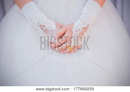 A wedding gold ring on the finger of the bride