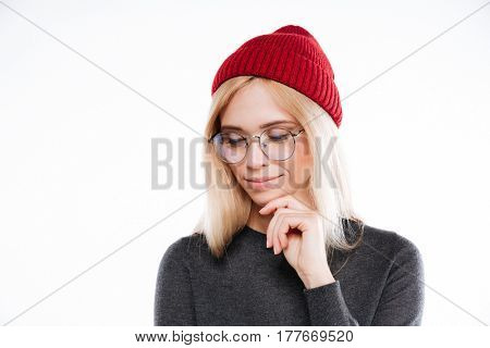 Close up portrait of a lovely blonde woman in hat and glasses looking away isolated on the white background