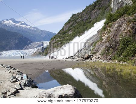 The view of Nugget Fall and Mendenhall Glacier in Mendenhall Glacier Recreation Area (Juneau Alaska).