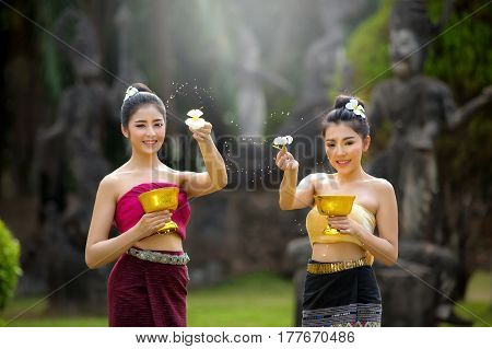 Laos girls splashing water durin tradition festival Laos Vientiane Songkran festival 2017