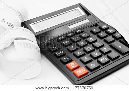 Calculator with adding machine tape, closeup