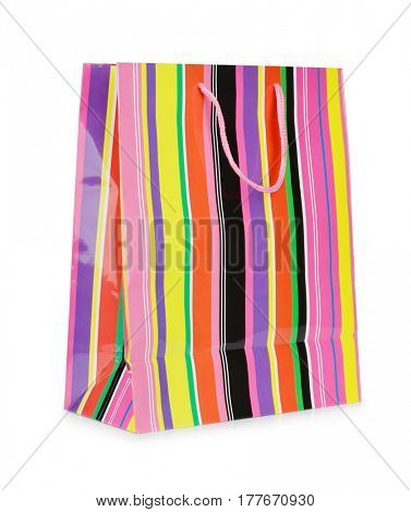 Single colorful striped paper shopping bag isolated on white