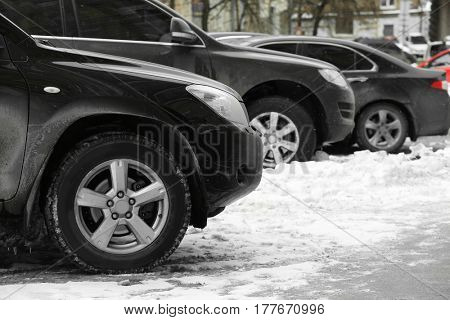 Parked cars after snowfall in winter time