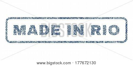 Made In Rio text textile seal stamp watermark. Blue jeans fabric vectorized texture. Vector tag inside rounded rectangular shape. Rubber emblem with fiber textile structure.