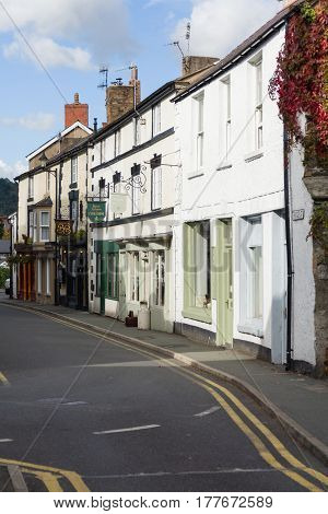 Llangollen Wales UK - October 9 2016: Bridge street in Llangollen with it's quaint terraced cottages and shops the town is a popular destination for visitors and tourists and also hosts the annual International musical Eisteddfod