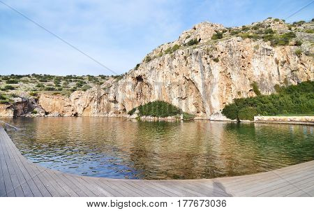 Vouliagmeni lake Greece - known for its constant temperature all the year - its underwater cave was never fully explored and many divers had been lost in it