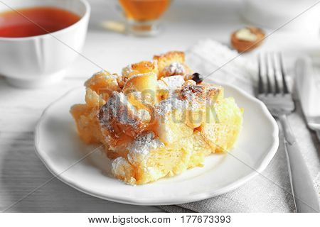 Delicious bread pudding with sugar powder on plate