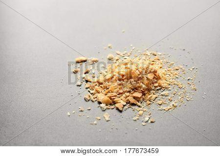 Heap of breadcrumbs on light background