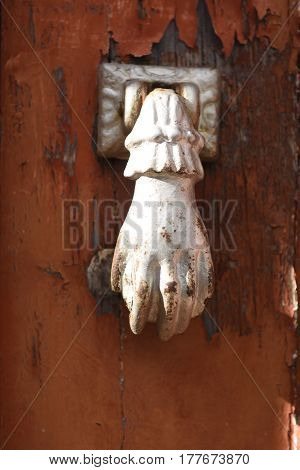 Detail of an Old knocker on a wooden door