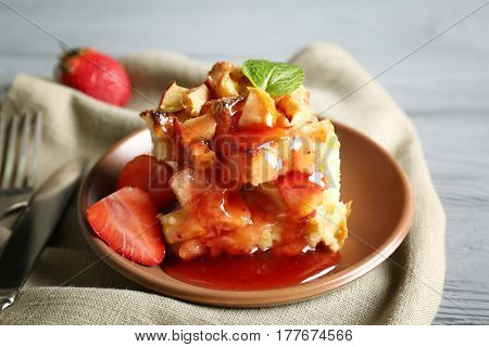 Delicious bread pudding with strawberry and jam on plate