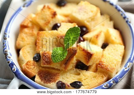 Bowl with delicious bread pudding, closeup