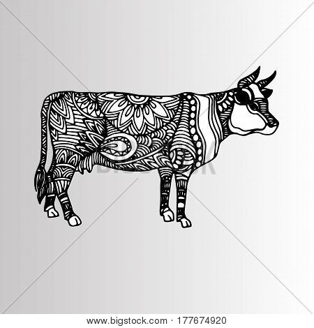 Silhouette of a cow with patterns and ethnic ornaments, ornaments of ancient tribes and peoples of India.