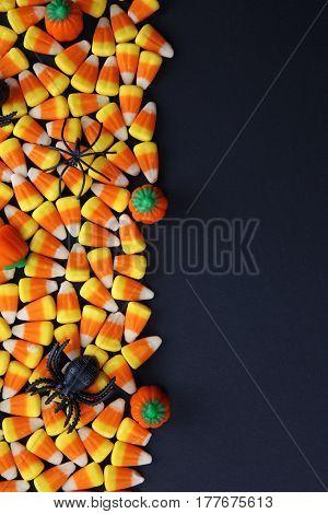 Tasty Halloween candies on dark background