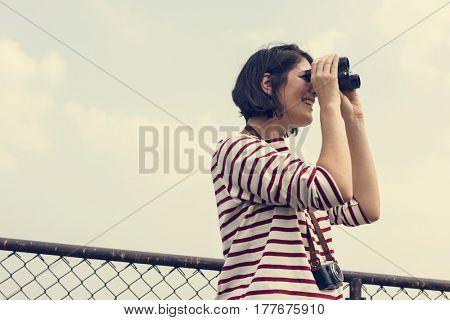 Adult Woman Using Binocular Watching Sky