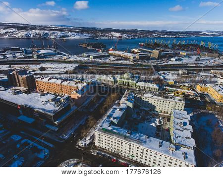 Beautiful aerial air winter vibrant view of Murmansk, Russia, a port city and the administrative center of Murmansk Oblast, Kola peninsula, Kola Bay, shot from quadrocopter drone