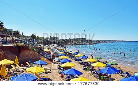 Hersonissos, Greece - July 14, 2016: Many people enjoy a summer day at the Star Beach of Hersonissos on the island of Crete in Greece.