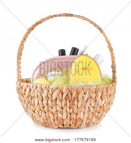 Easter basket with gifts on white background