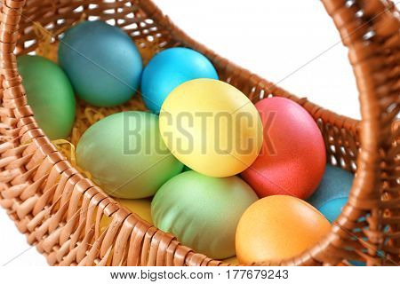 Easter basket with eggs on white background, close up