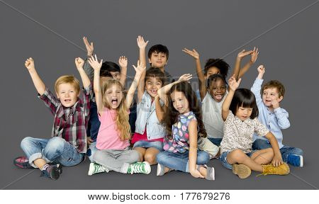 Group of happiness little children sitting on the floor