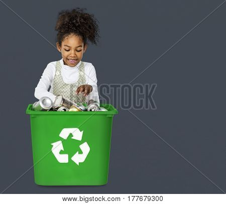 Ecology little girl separate and recycle stuff