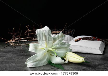 Easter white lily with Holy Bible on dark background