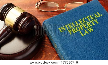 Book with title Intellectual Property Law and gavel.