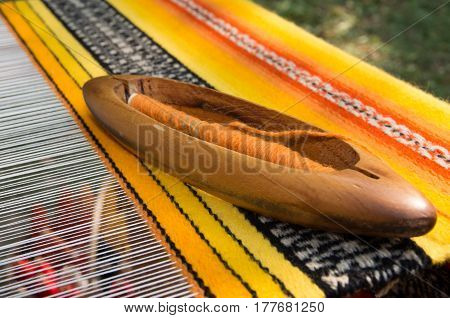 Crafts. Traditional weaving hand loom for carpets. Hand loom with many colorful woolen threads.