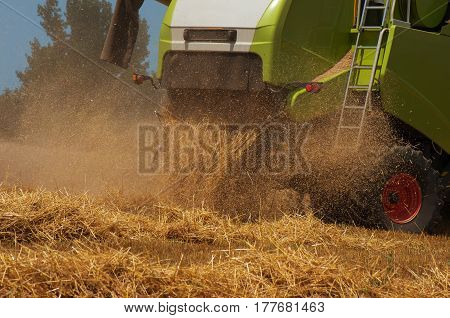 Combine harvester. Harvesting of wheat. Reaper reaps  crops at harvest, when they are ripe.