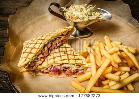 Beautifully served grilled sandwich with fries and cole slaw.