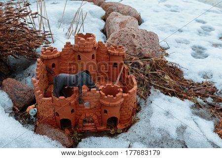 Designer accessory for a garden in the form of a castle. Photo in the winter.