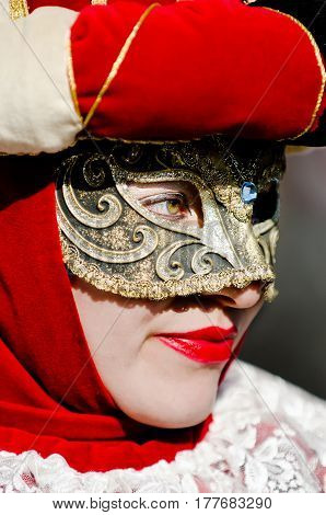 Venice, Italy - February 26th, 2011: deep look captured during the carnival parade in Piazza San Marco in Venice, the mask is to be photographed by photographers on the street.