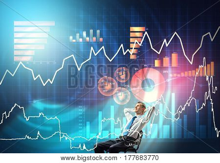 Young businessman sitting on chair with hands on head looking at virtual panel