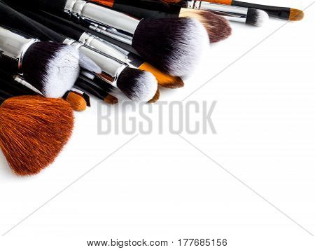 collected a professional makeup Brush and palette on a white background, Desk, make-up artist