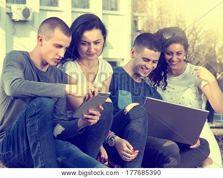 Friends With Laptop On Bench