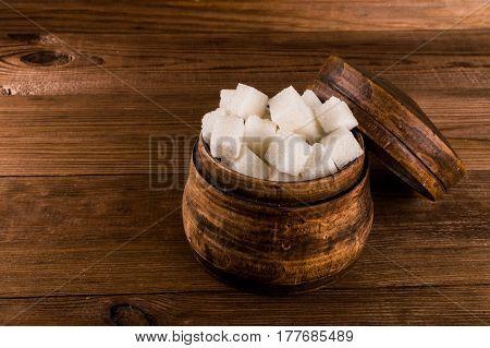 Diabetes. A lot of sugar cubes in jar.