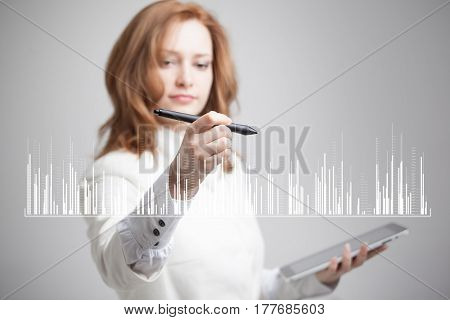 Finance data concept. Woman working with Analytics. Chart graph information on digital screen.