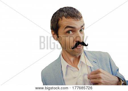 Portrait of an attractive young man dressed in a business style and fake mustache on an isolated white background